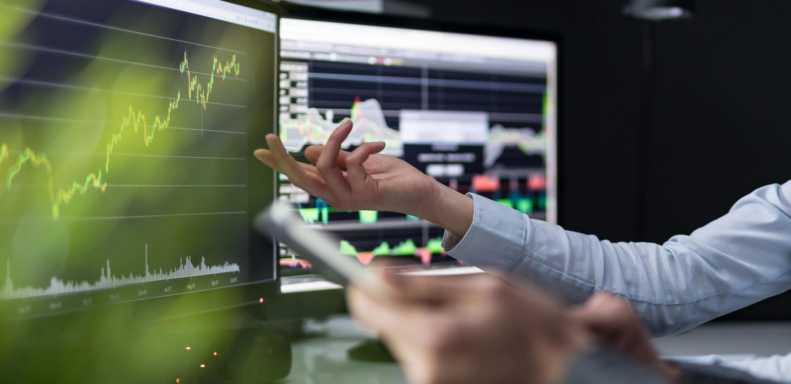Trading Software on two Computer Screens